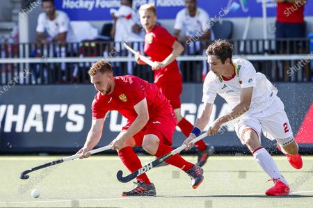 Georgii Arusiia (L) of Russia and Vicenc Ruiz (R) of Spain in action during the European Hockey Championship men pool A match between Spain and Russia at the Wagener Stadium in Amstelveen, Netherlands, 06 June 2021.