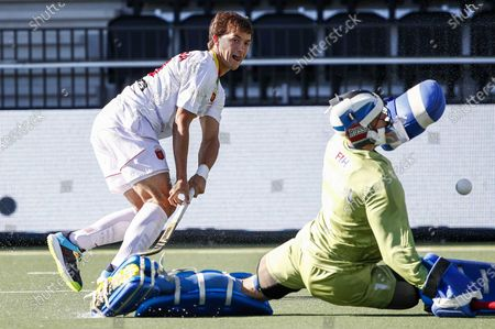 Jose Basterra (L) of Spain in action against Russia's goalkeeper Ivan Ozherelev during the European Hockey Championship men pool A match between Spain and Russia at the Wagener Stadium in Amstelveen, Netherlands, 06 June 2021.