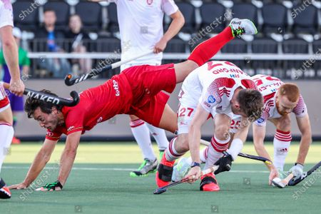 Arthur van Doren (L) of Belgium in action against English players Liam Sanford (C) and Jack Waller (R) during the European Hockey Championship men pool A match between England and Belgium at the Wagener Stadium in Amstelveen, Netherlands, 06 June 2021.
