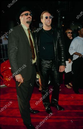 Actor Nicolas Cage and brother Christopher Coppola attend the 'Gone in 60 Seconds' Westwood Premiere on June 5, 2000 at Mann National Theatre in Westwood, California.