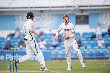 Yorkshire's David Willey celebrates dismissing Sussex's Stuart Meaker.