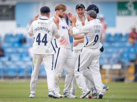 Yorkshire's David Willey is congratulated on dismissing Sussex's Stuart Meaker.