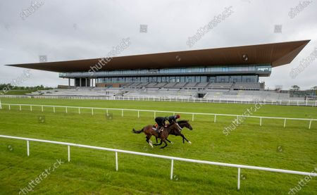 """Some of the leading contenders for this year's Dubai Duty Free Irish Derby exercised on the famous Curragh race track over the weekend as part of their preparation for the €1 million show piece, which takes place on Saturday 26th June. Aidan O'Brien was represented by High Definition, who landed the Group 2 Alan Smurfit Memorial Beresford Stakes as a two year old. The son of Galileo looked in very good order as he worked over 10 furlongs with Wayne Lordan in the saddle. Other Dubai Duty Free Irish Derby entries working on the track included the Joseph O'Brien trained Thunder Moon (Declan McDonagh) and Toshizou (Shane Crosse), while the Luke Comer trained pair of Seattle Creek and Seattle Sound were both put through their paces. Pat Keogh, Chief Executive of The Curragh, commented, """"The build up to the Dubai Duty Free Irish Derby has well and truly started and with the support of Dubai Duty Free, we were delighted to have the opportunity to invite all trainers with entries in the race to use the track over the weekend."""". The Dubai Duty Free Irish Derby Festival takes place from Friday 25th to Sunday 27th June with Saturday featuring the Dubai Duty Free Irish Derby at 3.45pm. Pictured are Michael Hussey on Carlisle Bay and Wayne Lordan on High Definition"""