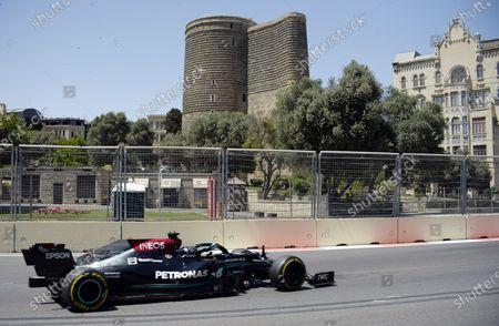 Stock Photo of (210606) - BAKU, June 6, 2021 (Xinhua) - Mercedes' Lewis Hamilton steers his car during the qualifying session at the Baku Formula One city circuit in Baku, Azerbaijan, June 5, 2021.