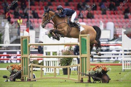 Malin Baryard-Johnsson from Sweden on H&M Indiana clears an obstacle during the Longines FEI Jumping Nations Cup of Switzerland at the CSIO Show Jumping in St. Gallen, Switzerland, 06 June 2021.