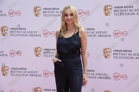 Jodie Comer poses for photographers upon arrival for the British Academy Television Awards in London