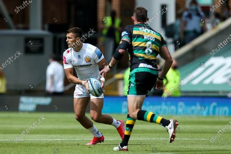 Stock Photo of Henry Slade of Exeter Chiefs takes on Tom Wood of Northampton Saints