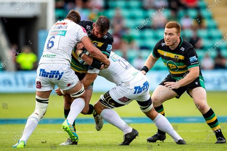 Tom Wood of Northampton Saints tackled by Lock/Back Row Sam Skinner of Exeter Chiefs during the Gallagher Premiership Rugby match between Northampton Saints and Exeter Chiefs at Franklins Gardens, Northampton