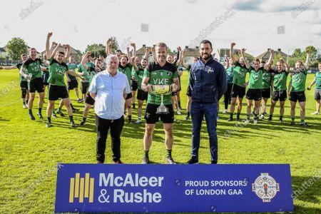 Fulham Irish vs Tir Chonaill Gaels. Fulham Irish captain Michael Murphy receives the winners trophy