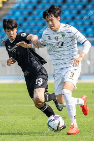 Stock Picture of Kim Min-Hyeok of Seongnam FC competes for the ball with Choi Hee-Won of Jeonbuk Hyundai Motors during the K League 1 match between Seongnam FC and Jeonbuk Hyundai Motors at the Tancheon Stadium in Seongnam, South Korea, 06 June 2021.