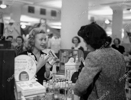 A customer purchasing Barbasol as a Father's Day gift from Priscilla Lane.