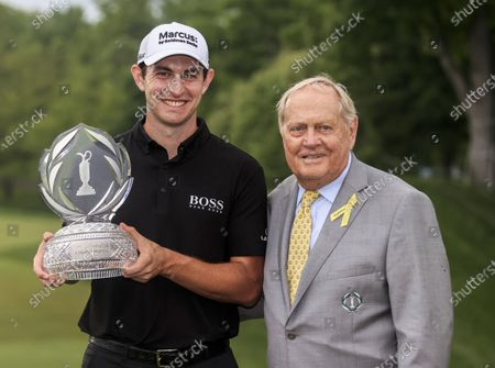 Stock Picture of Patrick Cantlay of the US (L) poses with golf great Jack Nicklaus (R) and the winner's trophy after winning The Memorial golf tournament at Muirfield Village Golf Club in Dublin, Ohio, USA, 06 June 2021.