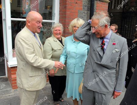 Prince Charles greets a local dignitary outside Jen Jones Quilt Centre in Lampeter