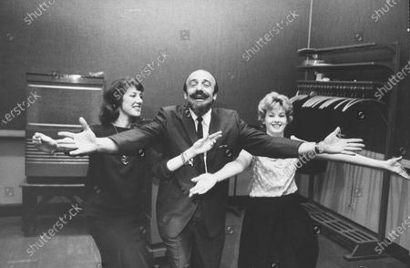 Mitch Miller (center) doing a new dance step, The Madison.