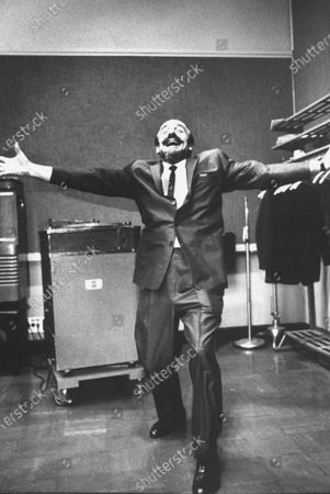 Mitch Miller doing a new dance step, The Madison.
