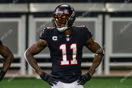 Atlanta Falcons wide receiver Julio Jones (11) warms up before an NFL football game against the New Orleans Saints in Atlanta. The Tennessee Titans have traded with the Atlanta Falcons for seven-time Pro Bowl wide receiver Julio Jones, a person familiar with the situation told The Associated Press