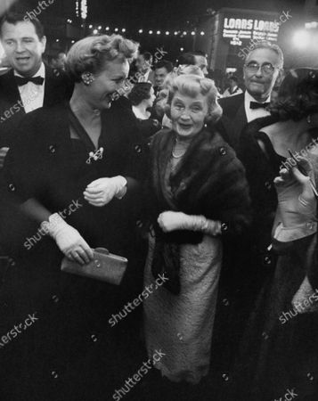 Stock Photo of Actress Billie Burke (fore, 3L) attending opening of new Huntington Hartford Theater.