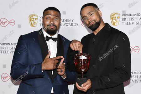 Jordan Banjo, left, and Ashley Banjo pose for photographers with their Must See Moment award in 'Britain's Got Talent' backstage at the British Academy Television Awards in London