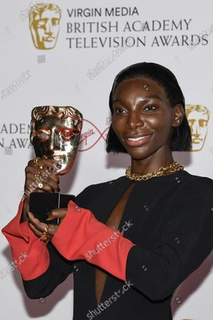Michaela Coel poses for photographers with his Leading Actress award for her role in 'I May Destroy You' backstage at the British Academy Television Awards in London