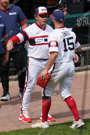 Chicago White Sox manager Tony La Russa, left, celebrates with Adam Engel after the Chicago White Sox defeated the Detroit Tigers in a baseball game in Chicago, . Tony La Russa is second on the managerial career wins list with 2, 764