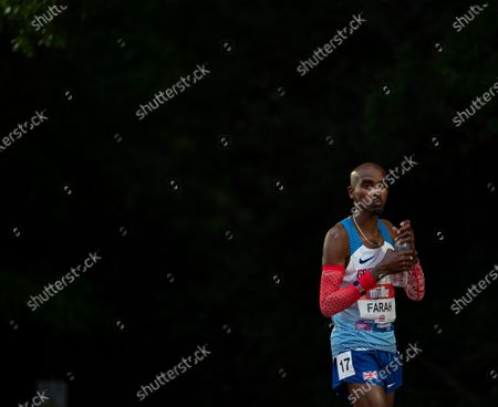 Mo Farah in the shadows; Birmingham University Athletics Track, Birmingham, Midlands, England; European 10000 Metre Finals, British Olympic Trials 10000 Metre.