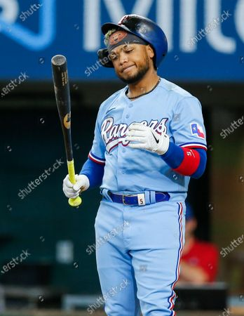 Stock Image of Texas Rangers' Willie Calhoun (5) reacts after a swing and a miss during the eighth inning of a baseball game against the Tampa Bay Rays, in Arlington, Texas