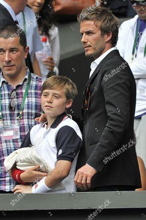 Stock Photo of Simon Oliveira, David Beckham with son, Brooklyn