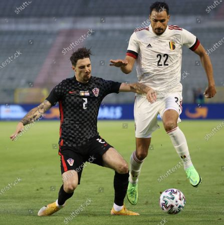 Croatia's Sime Vrsaljko and Belgium's Nacer Chadli fight for the ball during a friendly game of the Belgian national soccer team Red Devils and Croatia national team, in Brussels, part of the preparation for the Euro2020 tournament Sunday 06 June 2021.