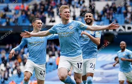 Manchester City's Kevin De Bruyne, centre, Manchester City's Phil Foden, left, and Manchester City's Riyad Mahrez celebrate scoring their side's first goal during the English Premier League soccer match between Manchester City and Everton at the Etihad stadium in Manchester. De Bruyne has been voted England's player of the season by his fellow professionals for a second consecutive year after helping his team regaining the Premier League trophy. The Belgium international is only the third man to retain the Professional Footballers' Association trophy after Thierry Henry in 2003 and 2004 while playing for Arsenal, and Cristiano Ronaldo in 2007 and 2008 during his Manchester United career