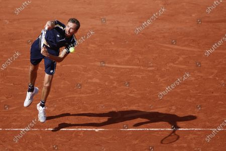 Stock Picture of Russia's Daniil Medvedev plays against Chile's Christian Garin during their men's singles fourth round tennis match on Day 8 of The Roland Garros 2021 French Open tennis tournament in Paris on June 6, 2021.