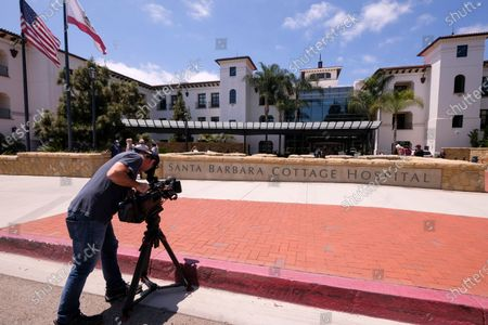"""Cameramen films outside the Santa Barbara Cottage Hospital, in Santa Barbara, Calif. The second baby for Prince Harry and Meghan is officially here: a healthy girl. A spokesperson said Sunday, June 6, 2021 that the couple welcomed their child Lilibet """"Lili"""" Diana Mountbatten-Windsor at 11:40 a.m. Friday at the California hospital"""