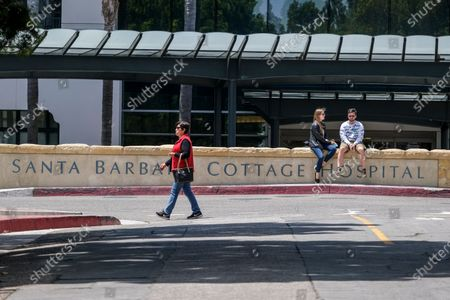 """People wait outside the Santa Barbara Cottage Hospital, in Santa Barbara, Calif. The second baby for Prince Harry and Meghan is officially here: a healthy girl. A spokesperson said Sunday, June 6, 2021 that the couple welcomed their child Lilibet """"Lili"""" Diana Mountbatten-Windsor at 11:40 a.m. Friday at the California hospital"""