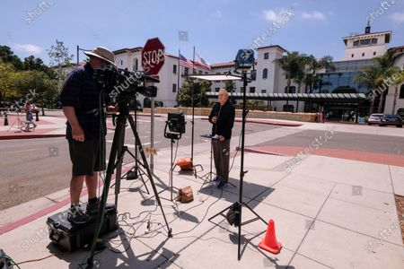 """Members of media are seen outside the Santa Barbara Cottage Hospital, in Santa Barbara, Calif. The second baby for Prince Harry and Meghan is officially here: a healthy girl. A spokesperson said Sunday, June 6, 2021 that the couple welcomed their child Lilibet """"Lili"""" Diana Mountbatten-Windsor at 11:40 a.m. Friday at the California hospital"""