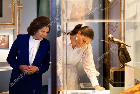"""Stock Image of Queen Silvia and Crown Princess Victoria visit the exhibition about Crown Princess Margareta which is shown at the Royal Palace. Curator Bronwyn Griffith guides., """"Meet a princess ahead of her time. Daisy, Crown Princess Margaret, 1882-1920. The exhibition will be shown at the Royal Palace June 6 - September 30, 2021"""