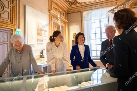 """The royal couple, the Crown Princess Victoria and Princess Christina Mrs. Magnuson visit the exhibition about Crown Princess Margareta which is shown at the Royal Palace. Curator Bronwyn Griffith guides., """"Meet a princess ahead of her time. Daisy, Crown Princess Margaret, 1882-1920. The exhibition will be shown at the Royal Palace June 6 - September 30, 2021"""