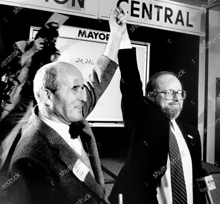 """Stock Image of Republican Tom Fink, left, celebrates after winning the runoff election in Anchorage, Alaska, for Anchorage mayor by more than 7,000 votes. Fink is with Democrat Dave Walsh, who conceded the election about two hours after the polls closed, holding Fink's arms up in a victory salute. Fink, a former speaker of the Alaska House of Representatives who later became mayor of Anchorage, has died. He was 92. Fink died of """"complications from old age,"""" his son, Josh Fink, said on"""