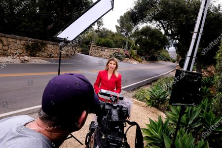 """Members of media are seen near a community gate of the home of Prince Harry The Duke of Sussex and Meghan Markle The Duchess of Sussex, in Montecito, Calif. A spokesperson said that the couple welcomed their child Lilibet """"Lili"""" Diana Mountbatten-Windsor at 11:40 a.m. Friday at the Santa Barbara Cottage Hospital"""