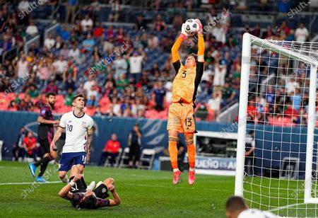 Stock Image of Mexico's Guillermo Ochoa (13) makes a save against the United States during the second half of a CONCACAF Nations League championship soccer match, in Denver