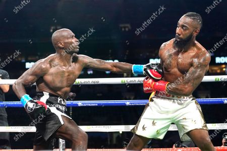 Former NFL wide receiver Chad Johnson, left, and Brian Maxwell fight during an exhibition boxing match at Hard Rock Stadium, in Miami Gardens, Fla