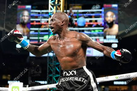 Former NFL wide receiver Chad Johnson fights Brian Maxwell during an exhibition boxing match at Hard Rock Stadium, in Miami Gardens, Fla