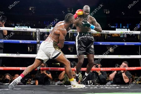 Brian Maxwell, left, and former NFL wide receiver Chad Johnson, right, fight during an exhibition boxing match at Hard Rock Stadium, in Miami Gardens, Fla