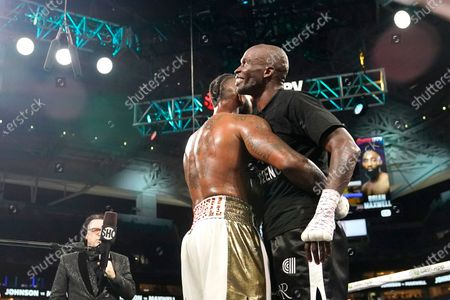 Brian Maxwell, left, and former NFL wide receiver Chad Johnson, right, embrace after an exhibition boxing match at Hard Rock Stadium, in Miami Gardens, Fla
