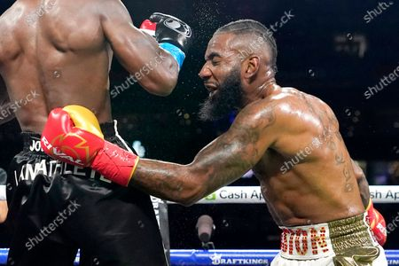 Former NFL wide receiver Chad Johnson, left, fights Brian Maxwell during an exhibition boxing match at Hard Rock Stadium, in Miami Gardens, Fla
