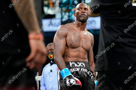 Former NFL wide receiver Chad Johnson walks in the ring before an exhibition boxing match against Brian Maxwell at Hard Rock Stadium, in Miami Gardens, Fla