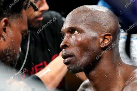Former NFL wide receiver Chad Johnson sits in-between rounds during an exhibition boxing match against Brian Maxwell at Hard Rock Stadium, in Miami Gardens, Fla