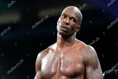 Former NFL wide receiver Chad Johnson stands in the ring during an exhibition boxing match against Brian Maxwell at Hard Rock Stadium, in Miami Gardens, Fla