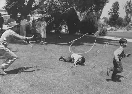 Johnny Crawford (L) child TV star playing during break from filming TV show `the rifleman'.