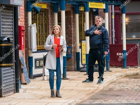 Stock Picture of Coronation Street - Ep 10354 & Ep 10355 Sunday 20th June 2021 Leanne Battersby, as played by Jane Danson, is horrified to hear the sound of gunshots. Seeing Nick and Sam sprawled on the ground, Leanne and Steve McDonald, as played by Simon Gregson, race towards them fearing the worst. Sharon Bentley watches from a distance, heart in mouth.