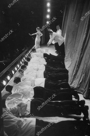 Stock Image of Comedian Singer, Nancy Dussalut (rear) in her college days at Northwestern Univ. singing Miss Student Body in the annuel spring revue.