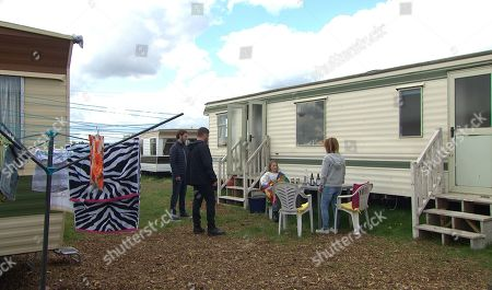Stock Image of Emmerdale - Ep 9072 & Ep 9073 Monday 14th June 2021 Aaron Dingle, as played by Danny Miller, and Ben Tucker, as played by Simon Lennon, arrive at Sandra Flaherty's, as played by Joanne Mitchell, caravan to find Liv Flaherty, as played by Isobel Steele, in the throes of a seizure. It turns out that this is Liv's second seizure in two days. Sandra's disturbed as she realises just how self-destructive Liv's recent behaviour has been.